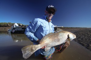 Black Jewfish Caught in Top End River with Bar Crusher 615SC Plate Aluminium Fishing Boat In Background