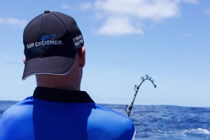 Fishing Wearing Bar Crusher Hat While Hooked Up